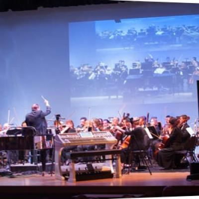 Maestro James Brooks-Bruzzese conducting the Symphony of the Americas.