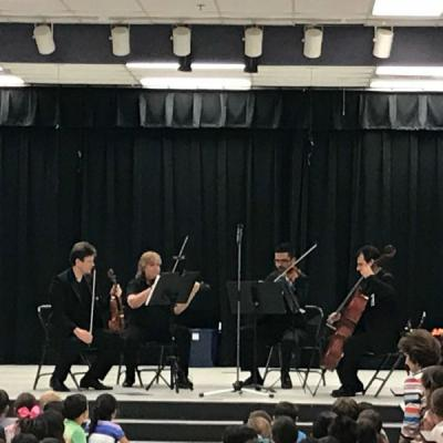 Symphony of the Americas musicians playing at Gator Run Elementary on December 5, 2017.  (From Left to Right): Valentin and Sandra playing the violin, David playing the viola, and Aziz playing the cello.